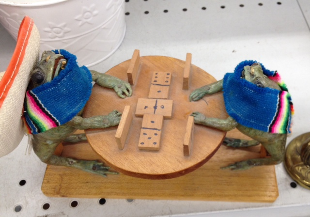 Frogs playing dominos